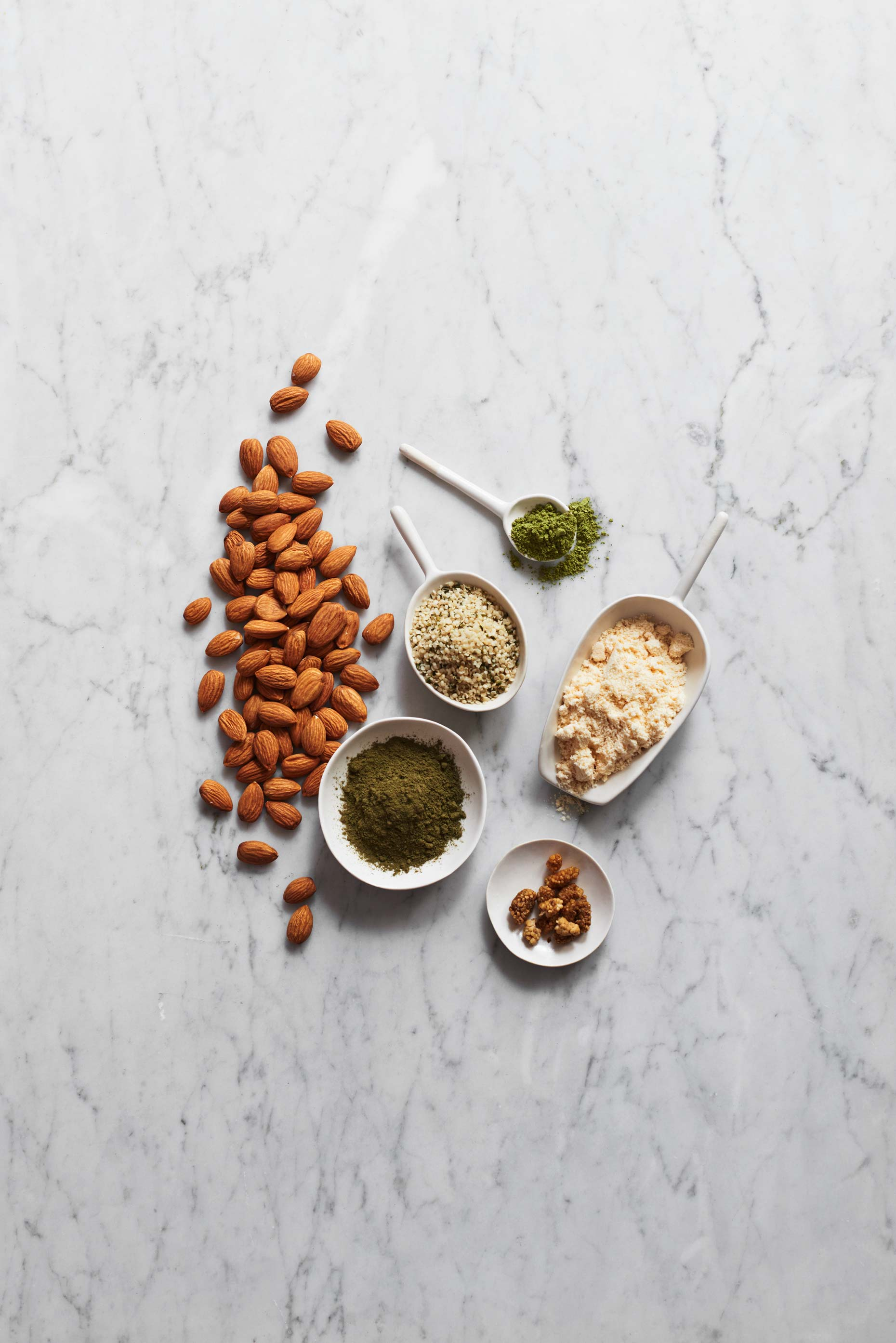 Green Ntidote ingredients photographed on white marble by Food Photographer Adrian Mueller New York