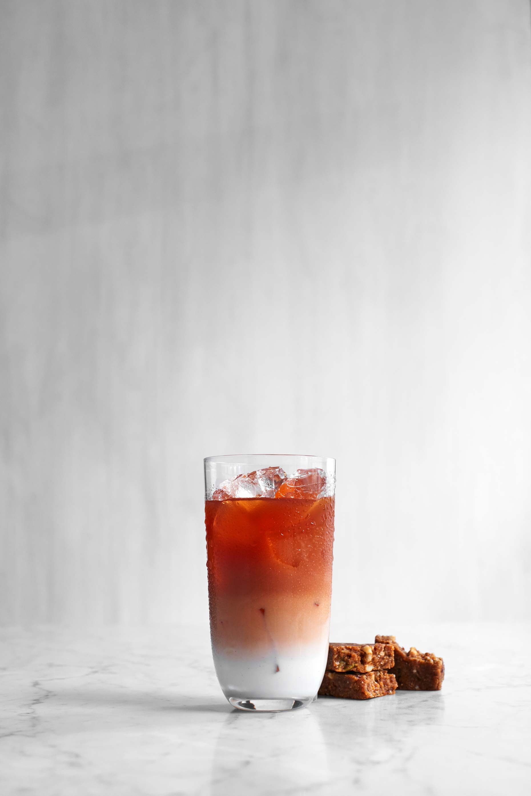 Red strawberry and raspberry smoothie photographed by Food Photographer Adrian Mueller New York