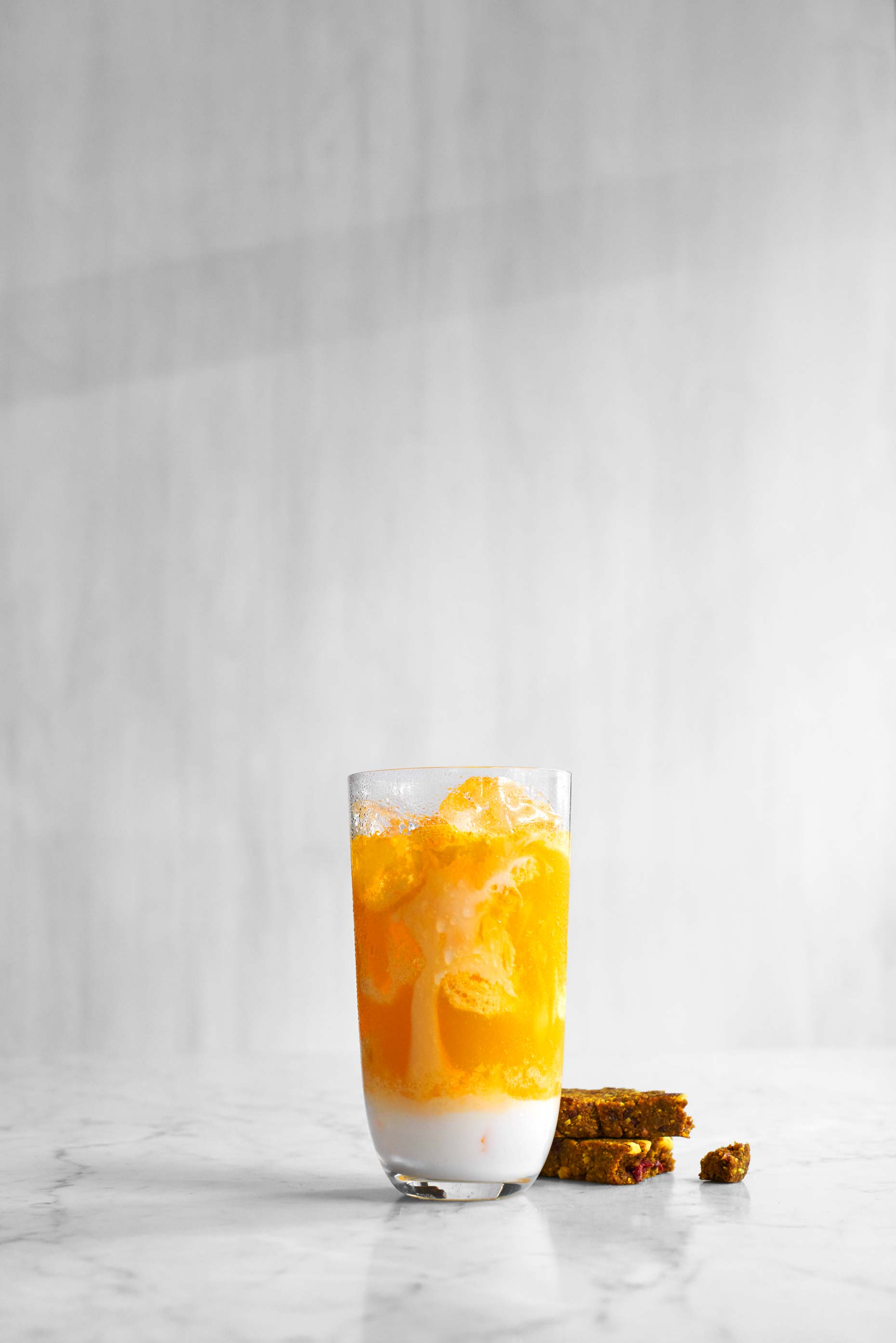 Yellow mango, banana and pineapple smoothie photographed by Food Photographer Adrian Mueller New York