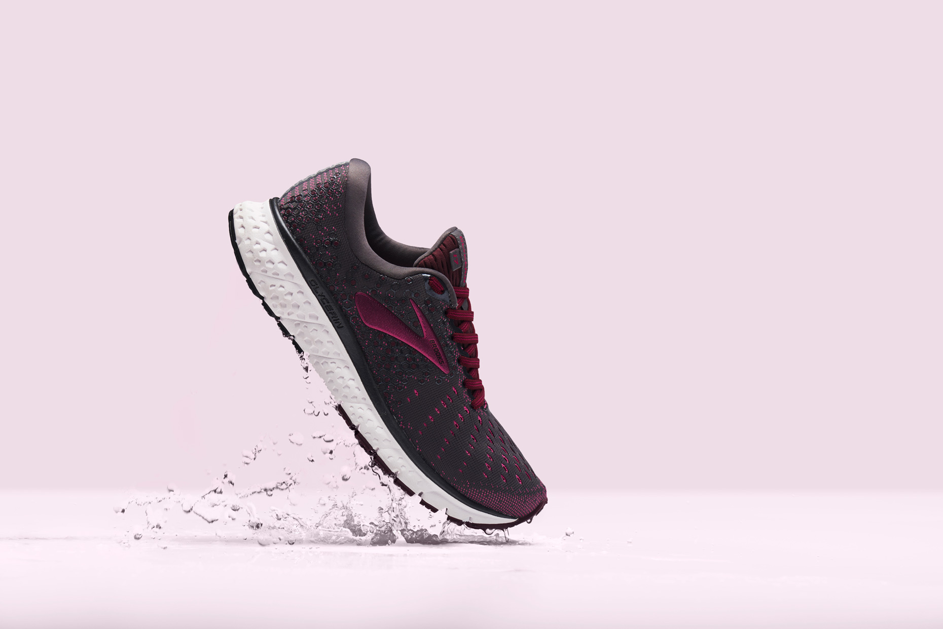 Brooks Street Running Shoe on a pink surface, by still life photographer Adrian Mueller New York