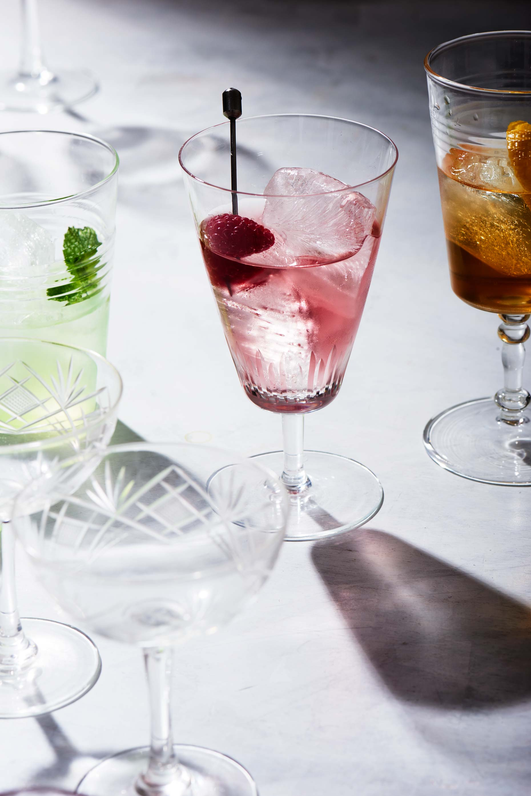 Various cocktails on a white table, shot  by Food and Beverage Photographer Adrian Mueller, New York